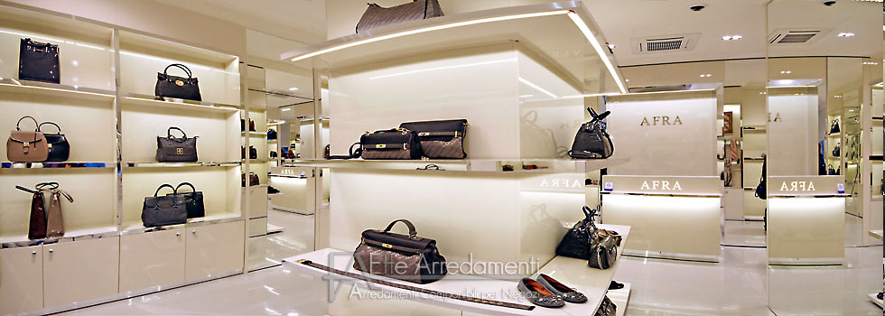 Arredamento negozio roma calzature e borse effe arredamenti for Arredamenti per hotel di lusso