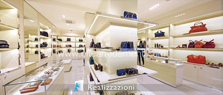 Arredamento negozio roma calzature e borse effe arredamenti for Arredamento roma est