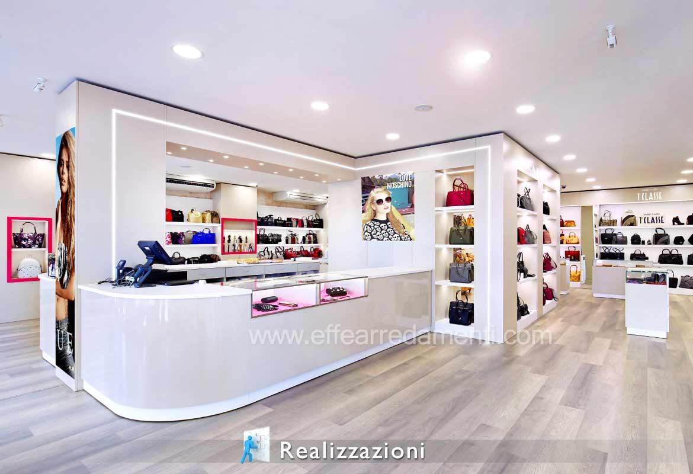 Esempio idee arredo negozio borse abbigliamento pelletteria