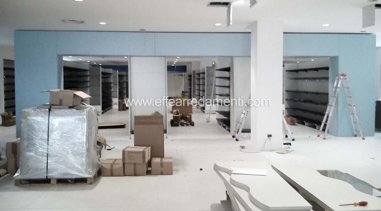 Allestimento montaggio negozio in corso d'opera a verona