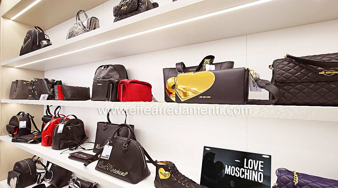 Furnishings with illuminated shelves For Love Moschino Bags Shop Made in Bastia Umbra.