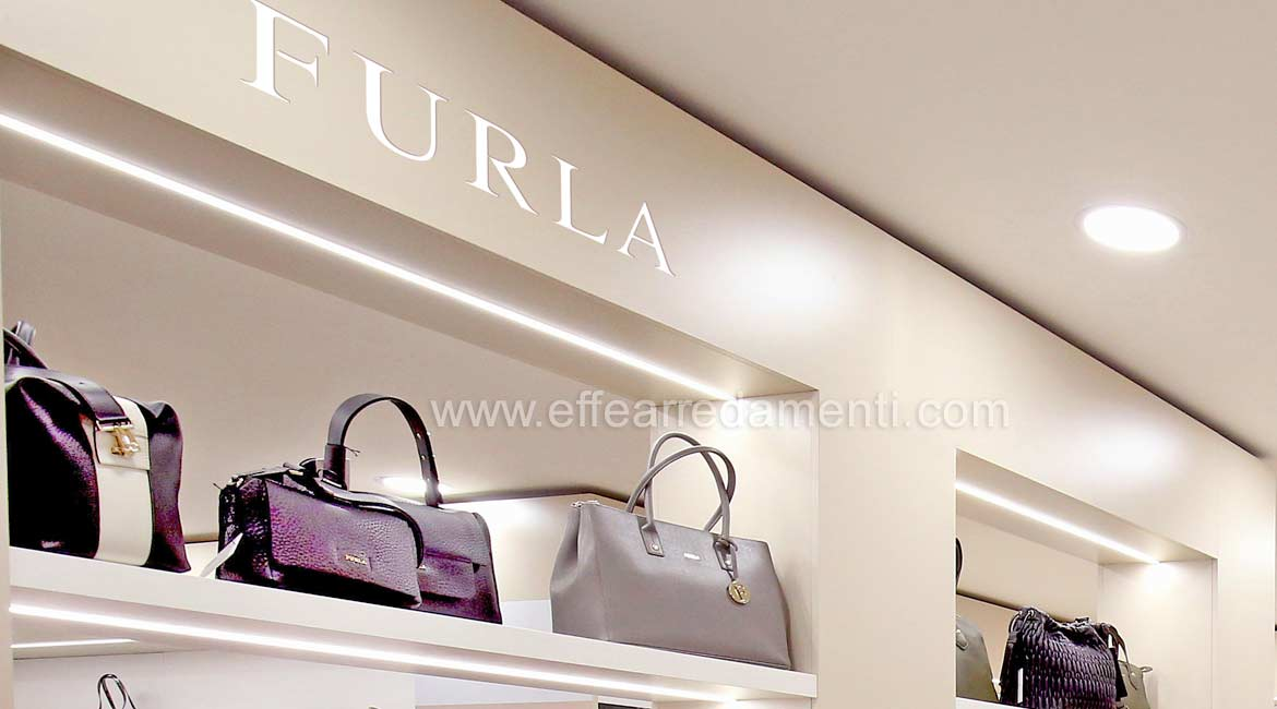 Open furniture with illuminated shelves For Exposure Furla and Prada bags
